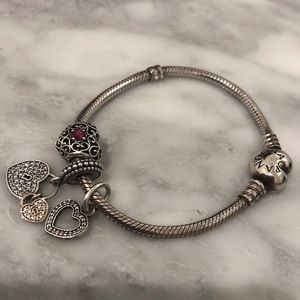Pandora bracelet with 3 charms (included)